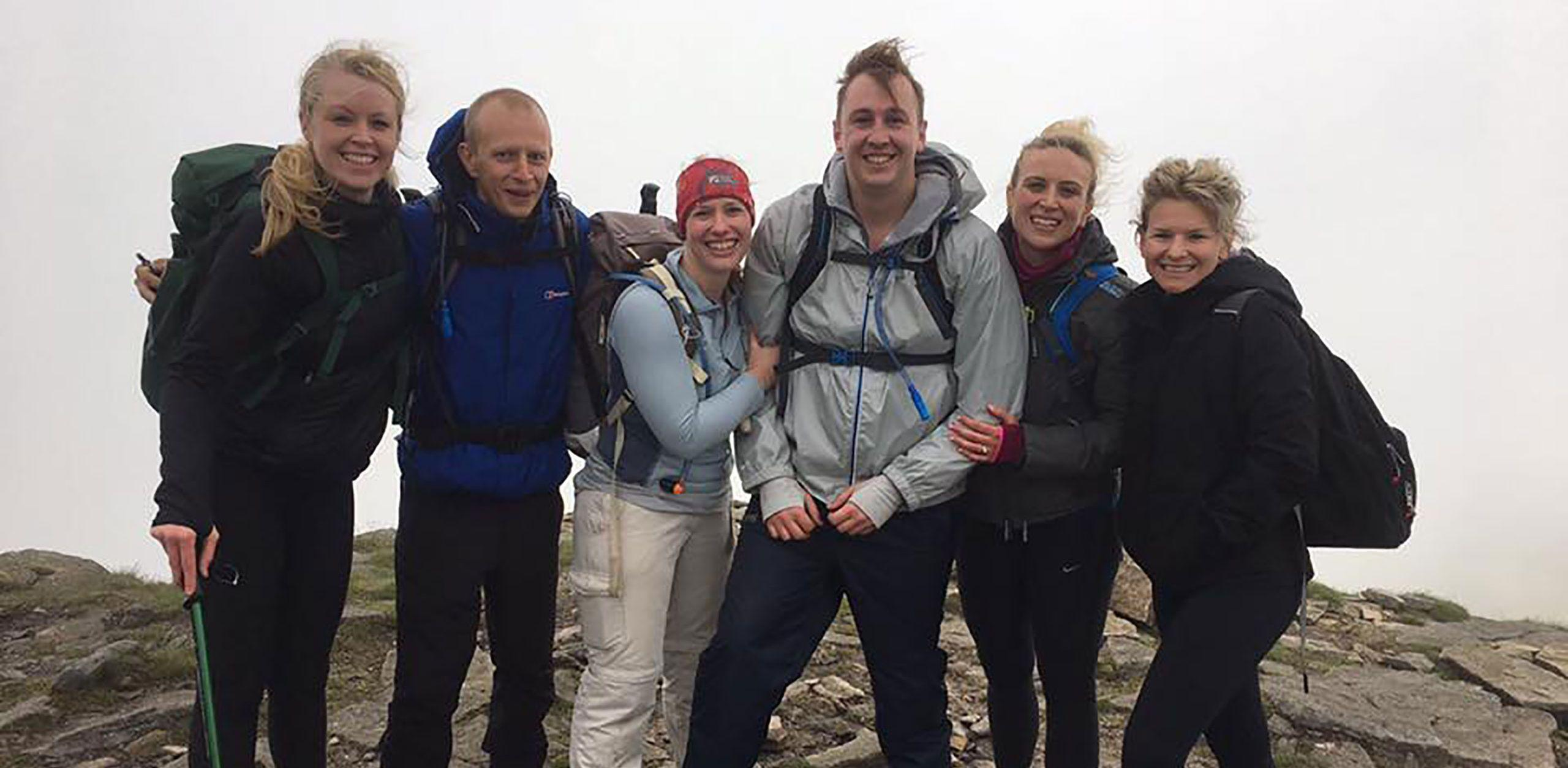 six D2 Rail staff members up a mountain